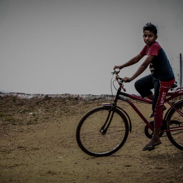 """""""boy on cycle"""" stock image"""