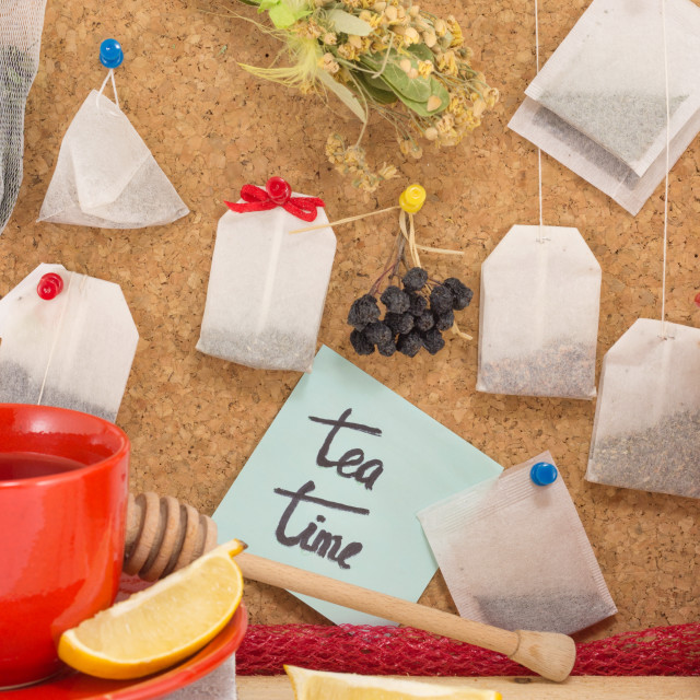 """Bunch of tea bags and cup of tea"" stock image"