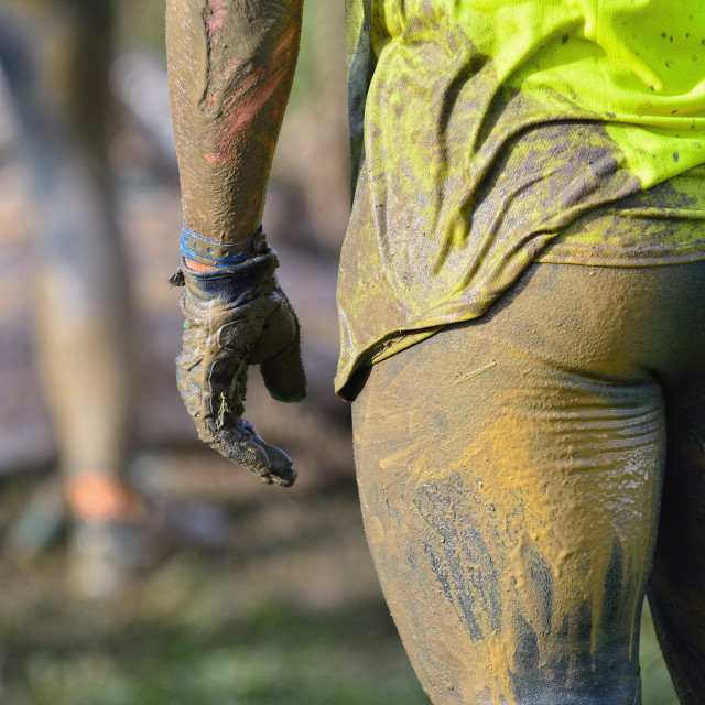 """Back view of sportsman in dirty sportswear"" stock image"