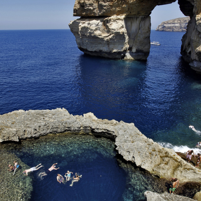 """Azur window and blue whole with swimmers and blue ocean at Gozo, near Malta,..."" stock image"