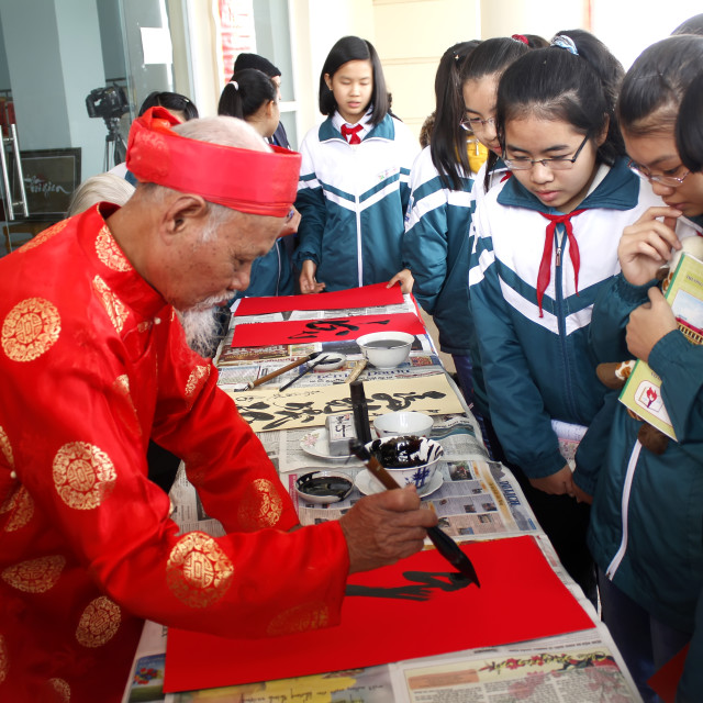 """""""HAI DUONG, VIETNAM, March 18: calligraphers writing art letters for visitors..."""" stock image"""