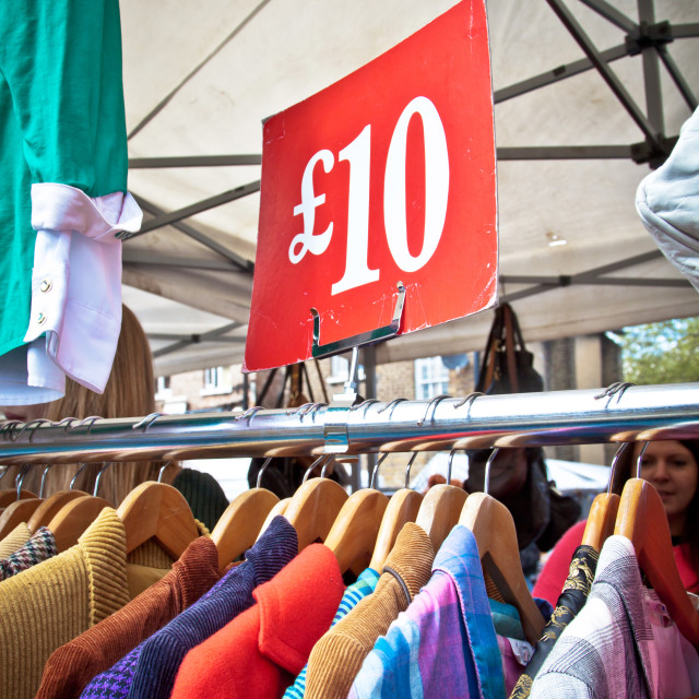 """""""A bargain for a tenner. Second hand clothes rack at market. Portrait..."""" stock image"""