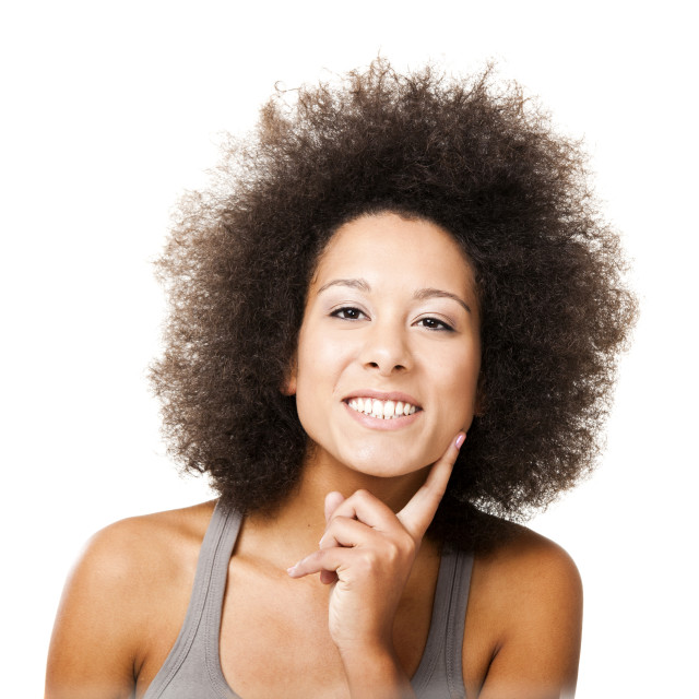 """""""Afro-American young woman smilling, isolated on white background"""" stock image"""