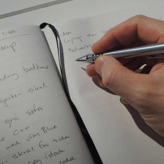 """""""Taking a few notes in my personal idea journal"""" stock image"""