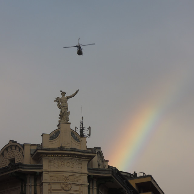 """""""Helicopter fetching the gold at the end of the rainbow"""" stock image"""