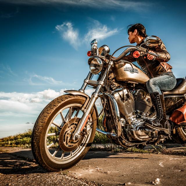 """MOSCOW, RUSSIA-JULY 7, 2013: Biker girl on Legendary bike Harley Sportster...."" stock image"