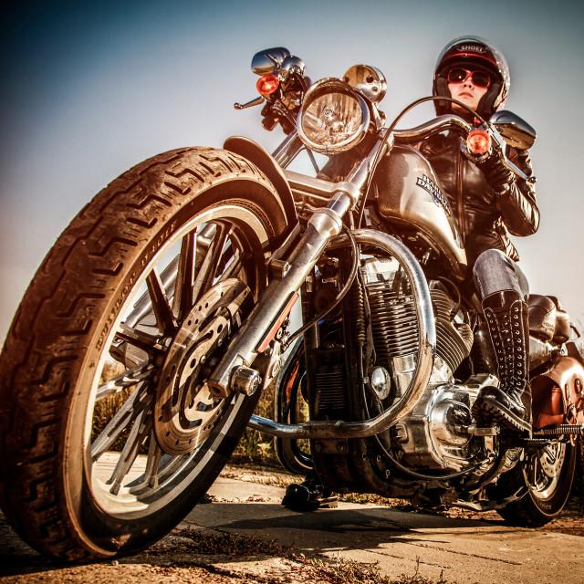 """MOSCOW, RUSSIA-JULY 7, 2013: Biker girl on legendary bike Harley Sportster..."" stock image"