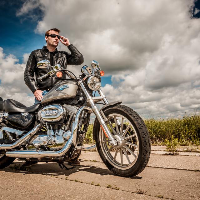 """MOSCOW, RUSSIA-JULY 7, 2013: Biker on Legendary bike Harley Sportster...."" stock image"