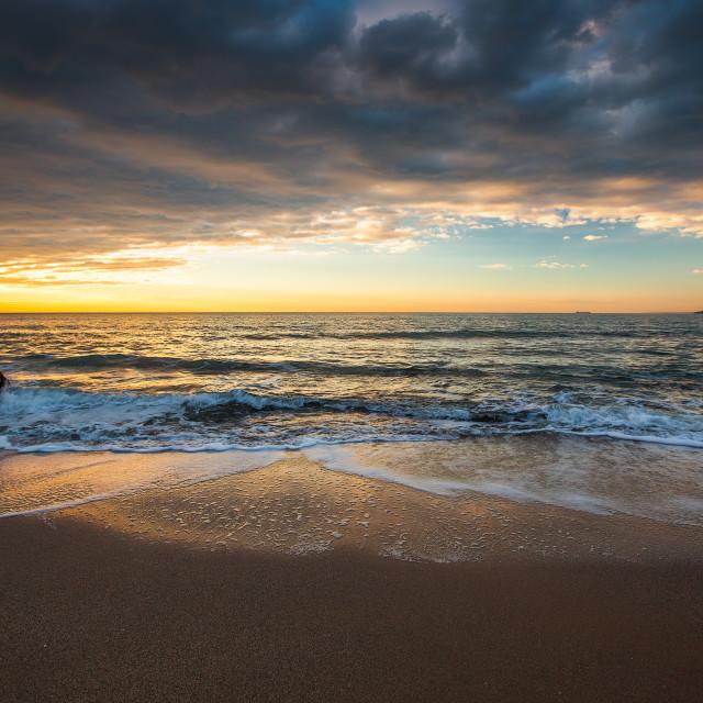 """Dramatic cloudscape over the sea, sunrise shot"" stock image"