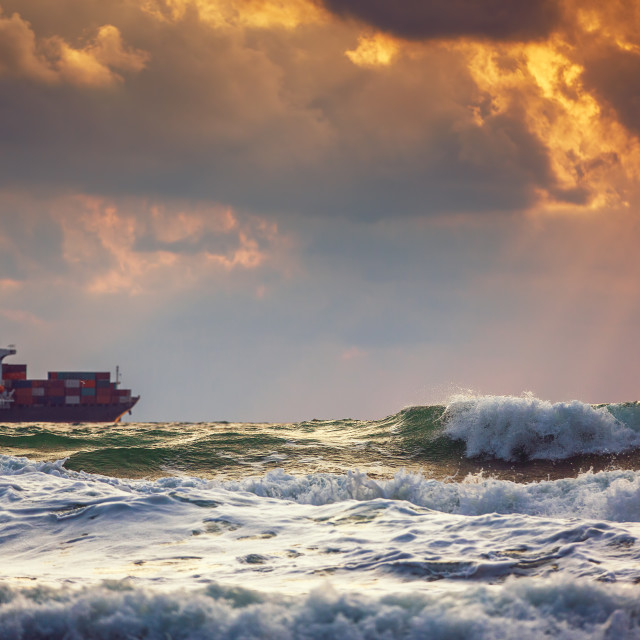 """""""Cargo ship with containers in sunrise light"""" stock image"""