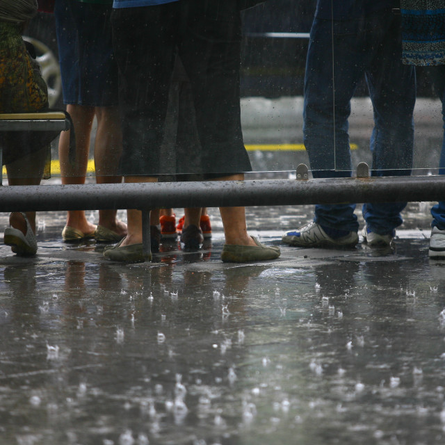 """""""urban people waiting on the bus station and street on the rain."""" stock image"""