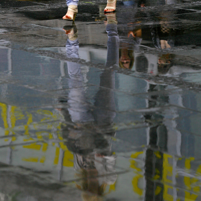 """""""woman reflection in the water after the rain"""" stock image"""