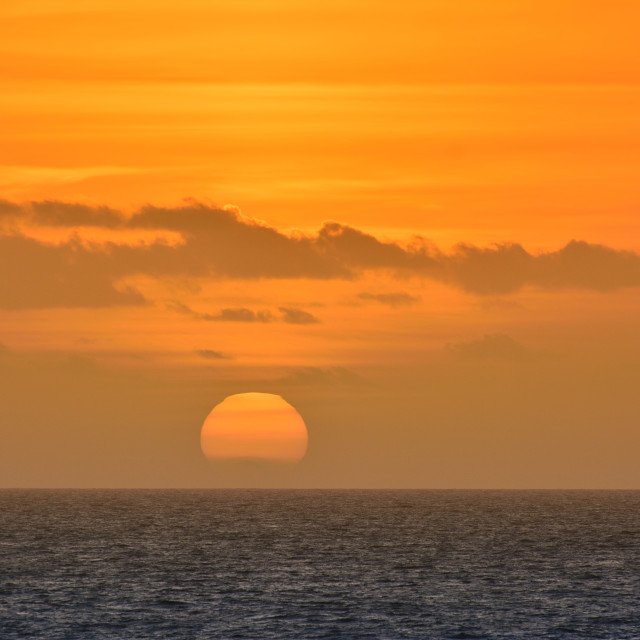 """View on scenic orange sunset at sea"" stock image"