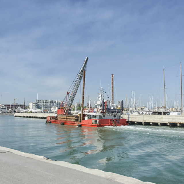 """Dredger coming into Rimini port"" stock image"