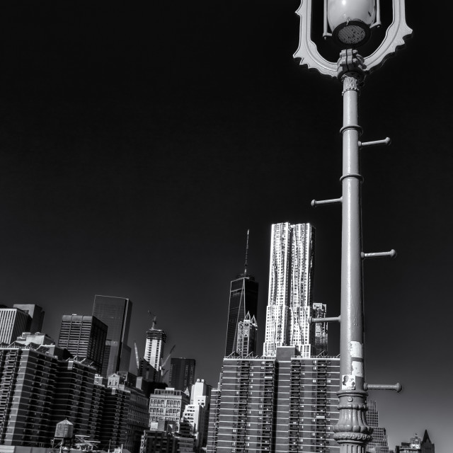 """Brooklyn Bridge street-light, Manhatten"" stock image"