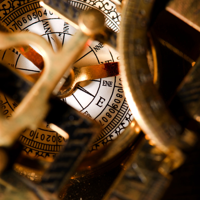 """""""Old compas in brass sun clock"""" stock image"""