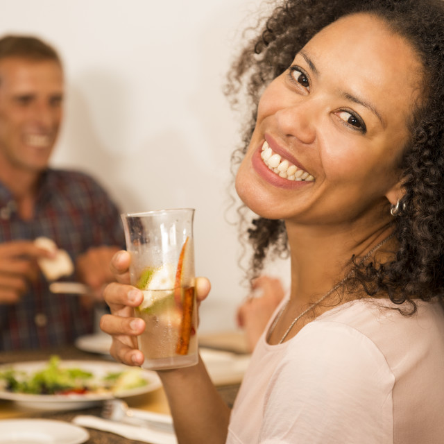"""""""Afro-american woman having a drink"""" stock image"""