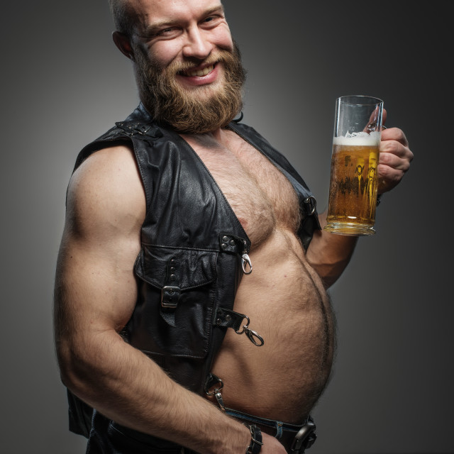 """""""Smiling biker with beer belly."""" stock image"""