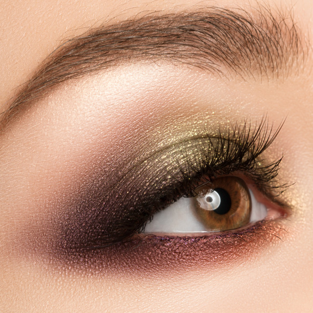 """Eye make-up with bright fashion golden-brown eyeshadow."" stock image"