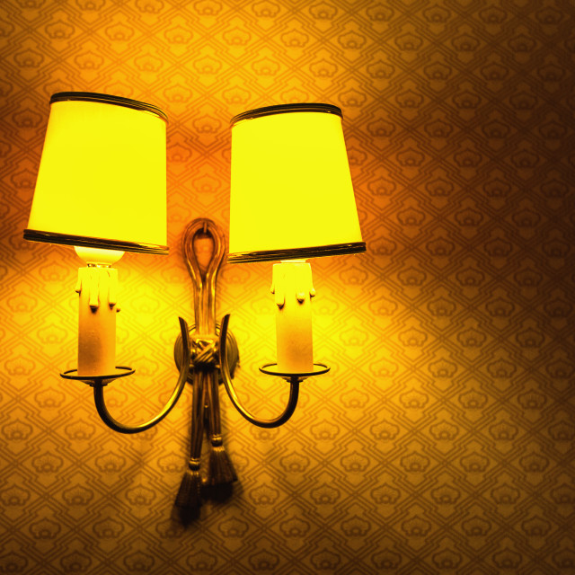 """Vintage lamp on the wall in the hotel room"" stock image"