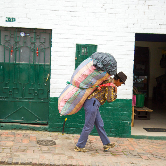 """""""Colombian Farmer carry a heavy weight"""" stock image"""