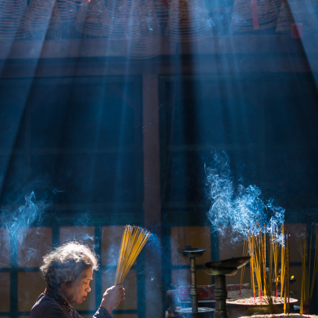 """old women with smoking prayer sticks at vietnamese pagoda"" stock image"