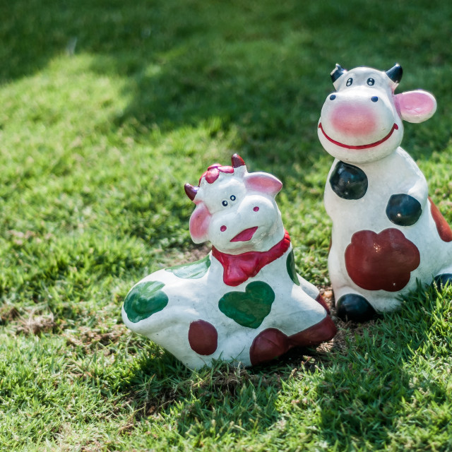 """""""Cows figurines on the grass."""" stock image"""