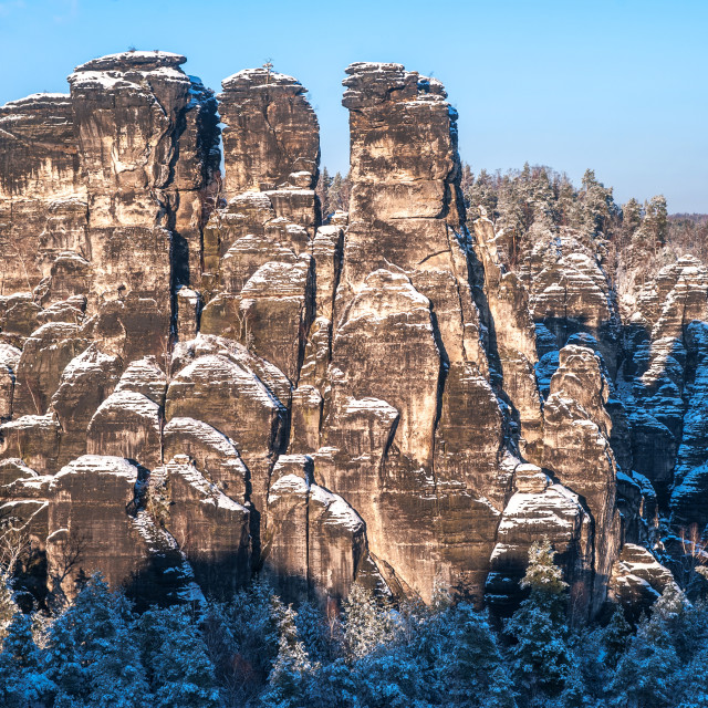 """Saxon Switzerland rock formation in winter time"" stock image"