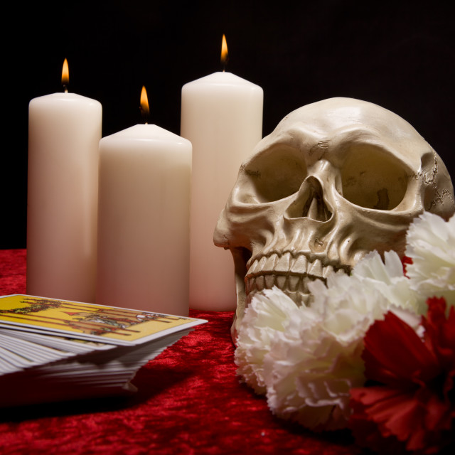 """Skull, Candles, Tarot Cards and Carnations"" stock image"