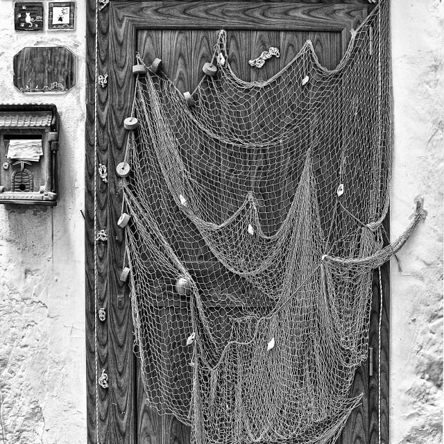 """fishing net used as decoration door of a house Sperlonga"" stock image"