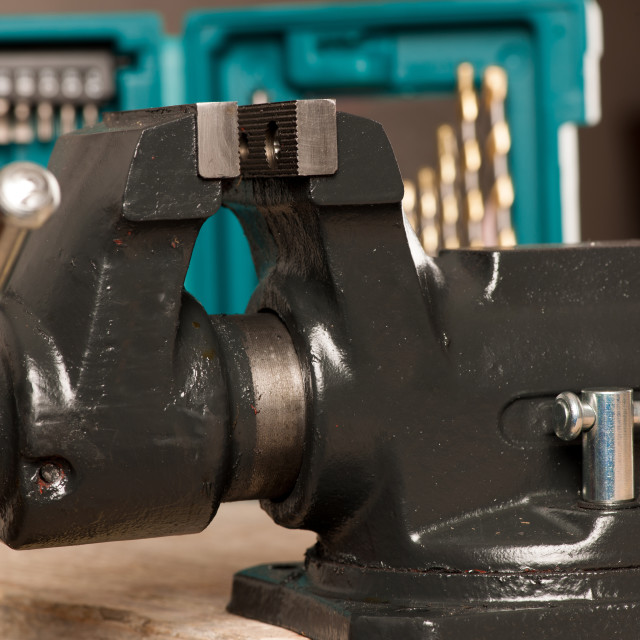 """""""Closeup of vice tool clamping device on wooden background."""" stock image"""