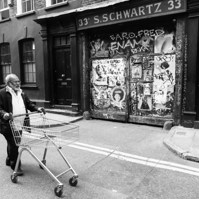 """Old man with empty shopping trolley"" stock image"