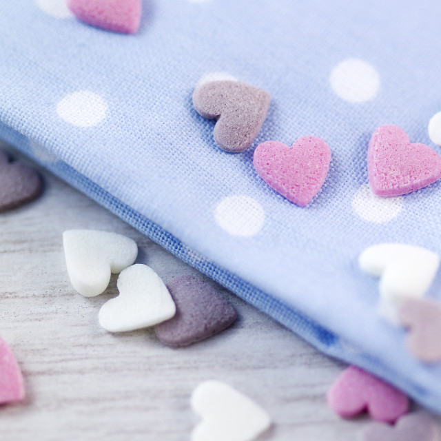 """Valentine heart cup cake decorations on baby blue polka dots"" stock image"