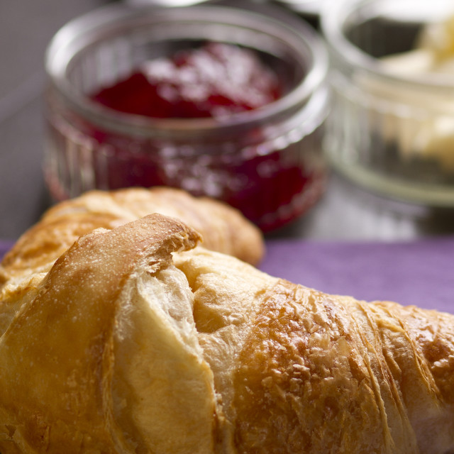 """Fresh croissant, jam and butter on dark"" stock image"
