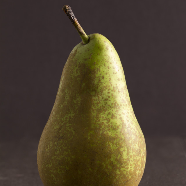 """Pear isolated on dark background"" stock image"