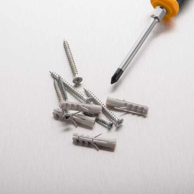 """Screwdriver, screws and plastic dowels"" stock image"