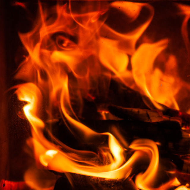 """Face in the flames"" stock image"