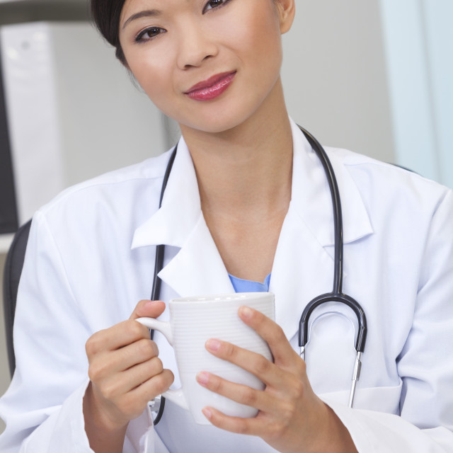 """""""Chinese Female Woman Doctor Drinking Coffee or Tea"""" stock image"""
