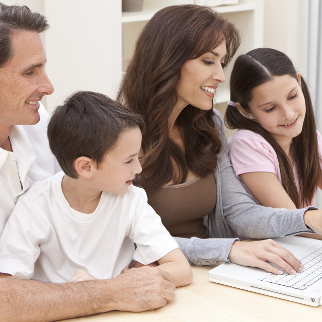 """""""Happy Family Having Fun Using Laptop Computer At Home"""" stock image"""