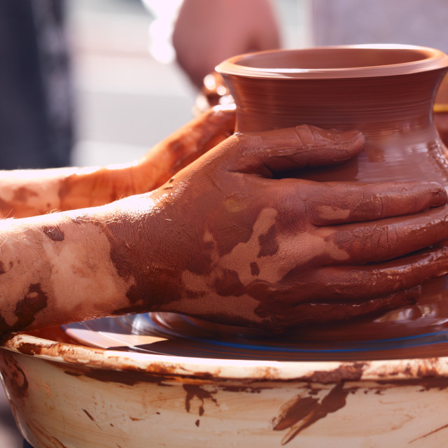 """Potter making the pot in traditional style."" stock image"