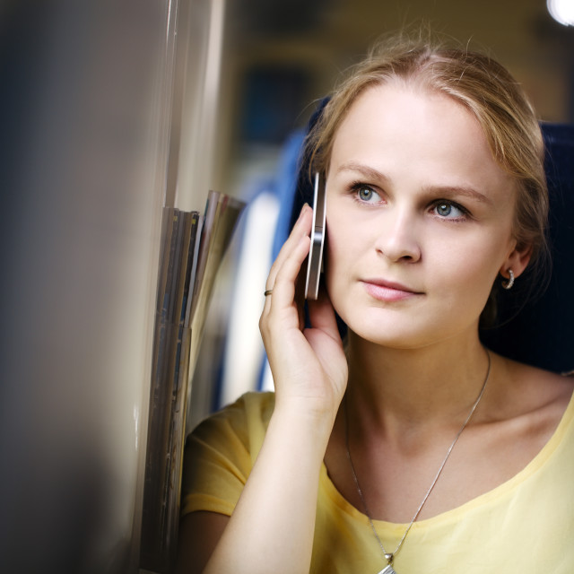 """""""Woman listening to a call on her mobile"""" stock image"""