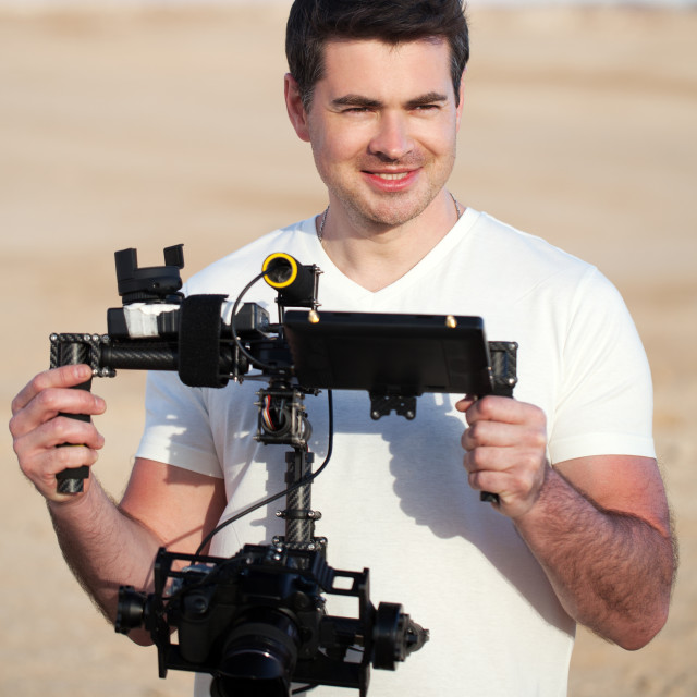 """""""Smiling man with steadicam equipment outdoor"""" stock image"""