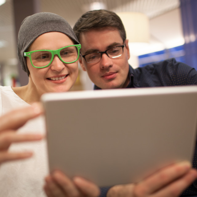 """Man and woman using electronic tablet in the restaurant"" stock image"