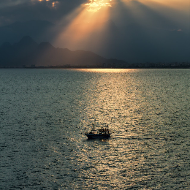 """Silhouette of ship in Antalya bay at sunset in Turkey"" stock image"