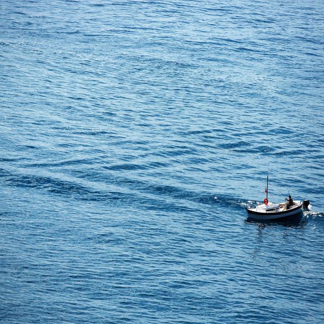 """Fisherman and fishing boat in the sea near Monaco"" stock image"