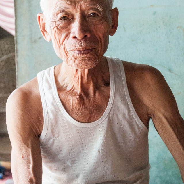 """Elderly Vietnamese Man"" stock image"
