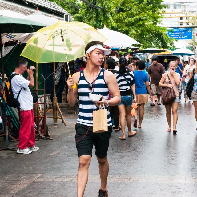 """Man yellow umbrella"" stock image"