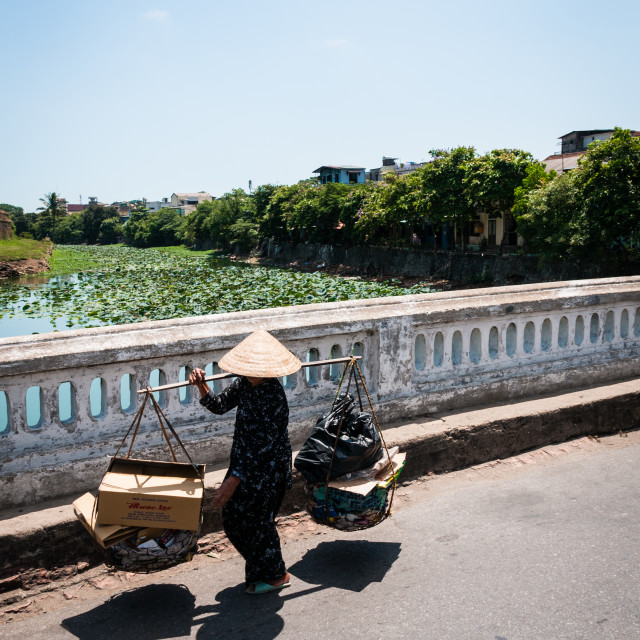 """Carrying produce in Hue"" stock image"