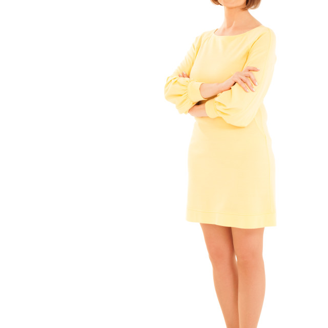 """""""Adult woman in yellow dress looking up"""" stock image"""