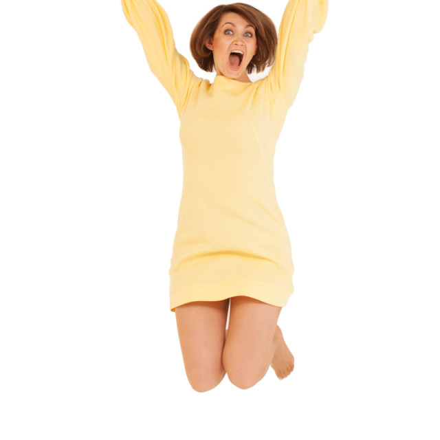 """""""Adult woman in yellow dress jumping"""" stock image"""